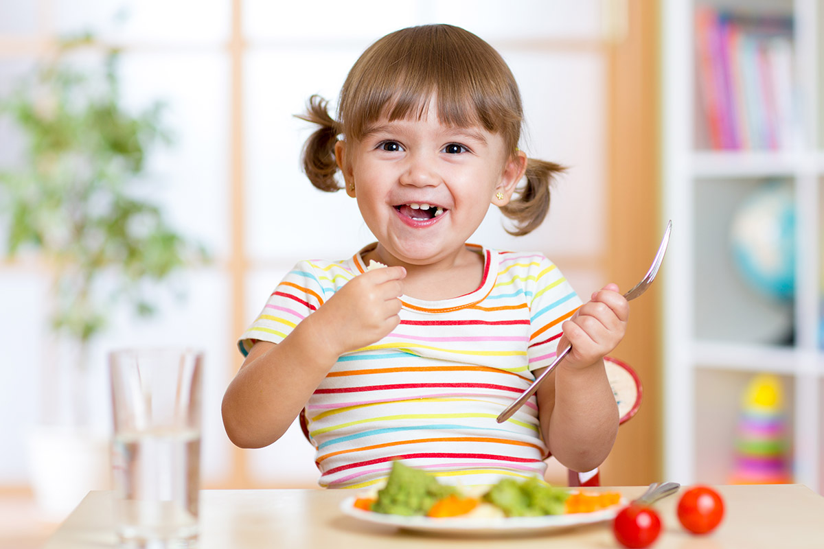 Cardiff Child Care Centre - children between 6 weeks and 6 years - small girl eating healthy